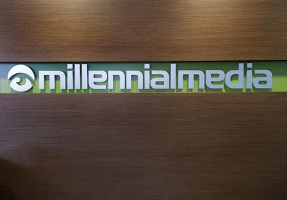 Millennial Media stock price rose 11 percent in early trading Friday after the company announced an increase in quarterly revenue but widened losses stemming from a one-time write-off of goodwill.