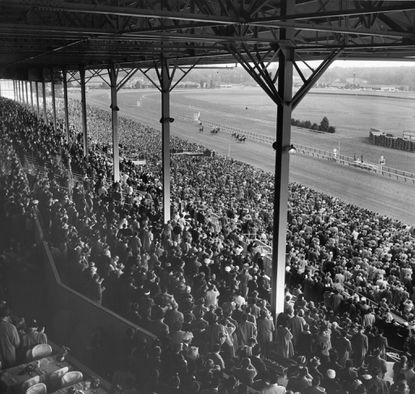 The crowd at Laurel Park watches the first race, as seen from the Turf Club.