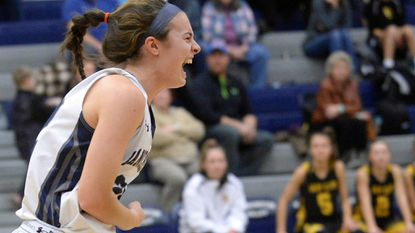 Manchester Valley senior Mackenzie DeWees reacts after scoring against South Carroll to surpass the all-time Carroll County girls basketball career scoring record Jan. 10. North Carroll's Caitlin Bach had the record of 1,782.
