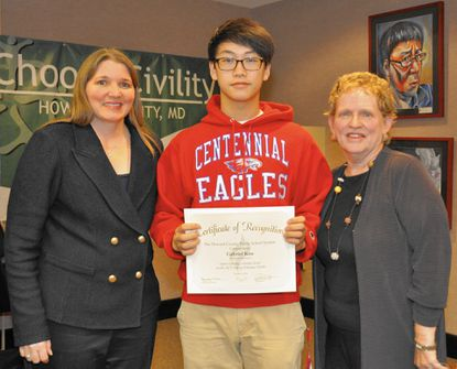 Gabriel Koo was honored at the Oct. 9 Howard County Board of Education meeting for his perfect score on the ACT. Standing with Koo is Superintendent Renee Foose, left, and Board of Education chair Ellen Flynn Giles, right.