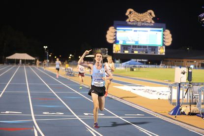 Johns Hopkins' Jared Pangallozzi crosses the finish line to win the 10,000-meter race at the 2021 NCAA Division III Outdoor Track and Field Championships at North Carolina A&T's Irwin Belk Track Complex in Greensboro, North Carolina. (D3Photography/Steve Frommell)