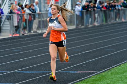 Oakland Mills senior Brit Lang, shown here at the Howard County championships earlier this month, won a 2A state title Thursday, May 26 in the 3,200-meter race.