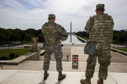 Members of the District of Columbia Army National Guard stand guard at the Lincoln Memorial in Washington, D.C. on Wednesday. Maryland also sent 120 members of the National Guard to the District of Columbia, and they returned on Saturday. (AP Photo/Manuel Balce Ceneta)