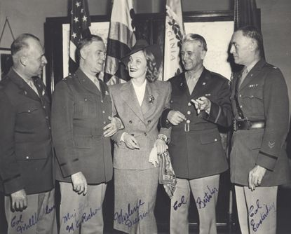 Actress Marlene Dietrich poses with Fort George G. Meade's commanders during an appearance in 1942.
