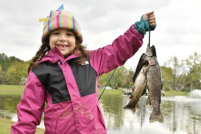 Kendall Castro, 6, of Lutherville, proudly shows off the three fish that she and her two brothers, Camden and Zach, caught during the annual Henry Fishing Rodeo at Westminster Community Pond. April 25, 2021