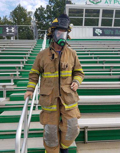 Senior firefighter John Kraft prepares for the Pelican Products 9/11 Memorial Stair Climb in Baltimore Oct. 13 by climbing Arundel High School's Football stadium bleachers multiple times in full firefighter gear.