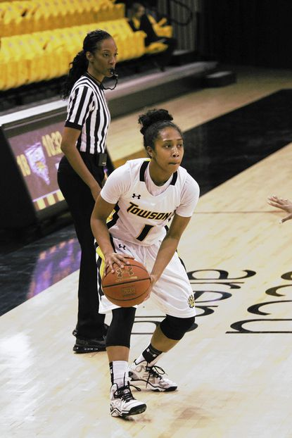 Former Laurel resident Dominique Johnson has averaged nearly 12 points and over four assists for Towson University. She is motivated by her brother's death in 2005.