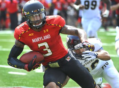 Maryland wide receiver Nigel King runs away from the the tackle of Florida International safety Mitch Wozniak in the second half of a 43-10 Terps win last season