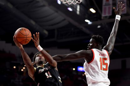 Adam Grant of Bryant shoots in front of Chol Marial of Maryland during the first half at Xfinity Center on December 29, 2019 in College Park.