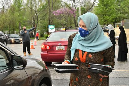 Donna Khan, a volunteer at the Islamic Society of Baltimore, offers Muslims iftar meals for breaking their Ramadan fast.