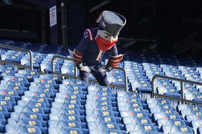 New England Patriots mascot Pat Patriots stares at empty stands at Gillette Stadium during the coronavirus pandemic before an NFL football game between the Patriots and the Arizona Cardinals, Sunday, Nov. 29, 2020, in Foxborough, Mass. (AP Photo/Elise Amendola)