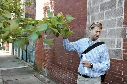 Morgan Grove, research scientist with the USDA Forest Service, is co-author of a study that finds neighborhoods with the most trees in public areas have lower crime rates.