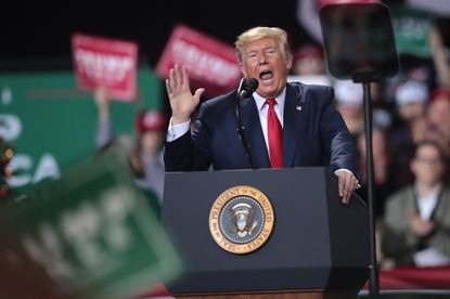 President Donald Trump speaks at his Merry Christmas Rally at the Kellogg Arena on Dec. 18, 2019, in Battle Creek, Mich. While President Trump spoke at the rally the House of Representatives voted, mostly along party lines, to impeach him for abuse of power and obstruction of Congress, making him just the third president in American history to be impeached.