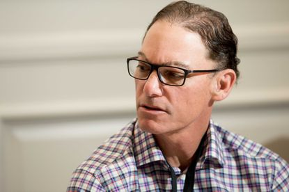 Former Bears coach and new Ravens offensive coordinator Marc Trestman speaks to reporters in March.