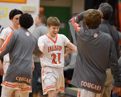 Fallston's Connor Disharoon celebrates with his team after a big three-point shot during Friday night's home playoff game against Rising Sun.