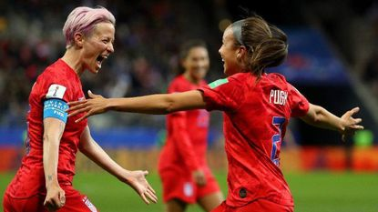 Mallory Pugh of the USA celebrates with teammate Megan Rapinoe after scoring her team's eleventh goal during the 2019 FIFA Women's World Cup France group F match between USA and Thailand at Stade Auguste Delaune. (Robert Cianflone/Getty Images)