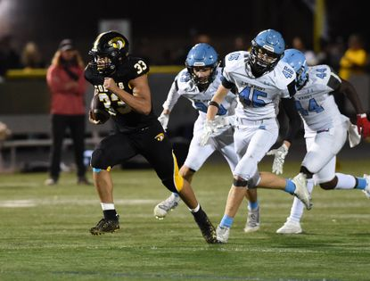Harford Tech ball carrier Kelvin Mendez gets through the C Milton Wright defense and sprints for a big gain on a carry during the game Friday, October 1, 2021 at Harford Tech.