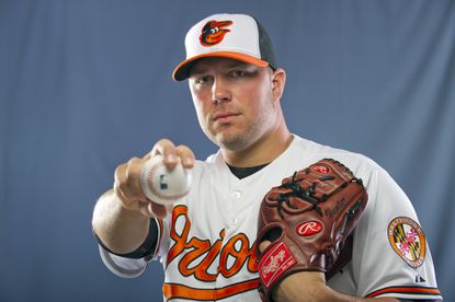 Orioles pitcher Tommy Hunter, the heir apparent to Jim Johnson as the team's closer, poses during the team's photo day at the Orioles' spring training facility in February.