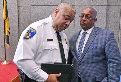 """Baltimore's top elected officials got a pay raise as of Jan. 1, boosting Mayor Bernard C. """"Jack"""" Young's annual salary from roughly $185,000 to almost $190,000. Young, right, is shown in this Dec. 16, 2019, photo with Police Commissioner Michael Harrison."""