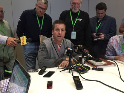 Baltimore Ravens coach John Harbaugh speaks to the media during the NFL Owners meeting in Boca Raton, Florida.