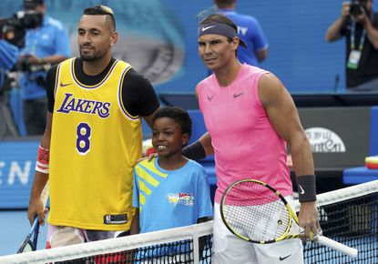 Australia's Nick Kyrgios poses for a photo with Rafael Nadal, wearing a jersey as a tribute to Kobe Bryant ahead of his fourth round singles match at the Australian Open tennis championship.