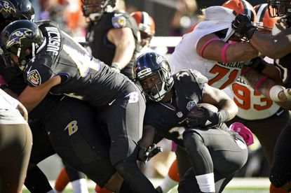 Ravens running back Buck Allen (37) looks for room as he runs into fullback Kyle Juszczyk (44) during a fourth quarter play near the goal line. The Ravens lost to the Browns, 33-30, in overtime at M&T Bank Stadium.