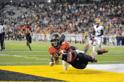 University of Maryland tight end Dave Stinebaugh, a Perry Hall High graduate, catches the winning touchdown Oct. 12 in the Terps' 27-26 victory over Virginia.He has 11 catches for 162 yards for a 5-2 team.
