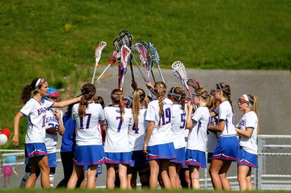 Centennial's JV girls lacrosse team gets together during its game against Mt. Hebron May 4. To read about some of the standout JV teams and players from the spring season, check out this year's round-up.