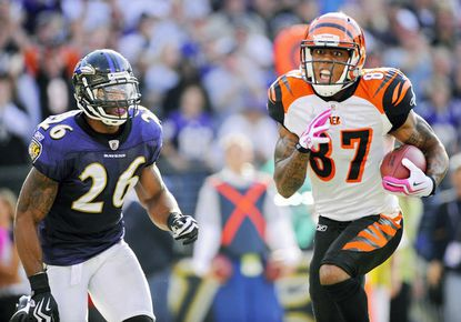 Cincinnati Bengals wide receiver Andre Caldwell, right, scores the winning 20-yard touchdown ahead of Ravens safety Dawan Landry with 22 seconds remaining.