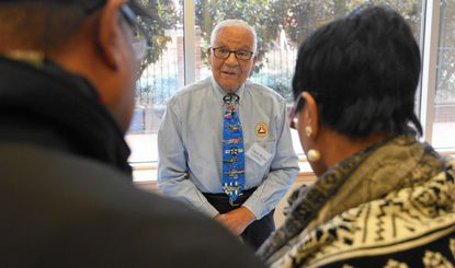 Col. Charles E. McGee, a Tuskegee Airman who holds a record of 409 combat missions in three wars, speaks to visitors to the Reginald F. Lewis Museum of Maryland African American History & Culture.
