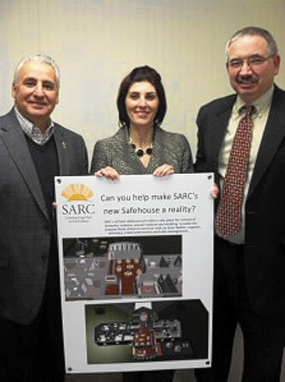 Rocky Gonzalez, left, chairman of the Phelan Safehouse Campaign, Luisa Caiazzo, CEO of SARC, and Tom Phelan, Chesapeake Employers' Insurance Co. CEO, meet on behalf of the new Phelan House project.