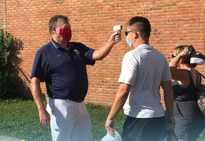 Hall of Fame coach Dave Cottle helped conduct temperature checks for all participants and family members at the Bay Bridge Brawl, a HoganLax tournament that preceded the Naptown Challenge this summer.