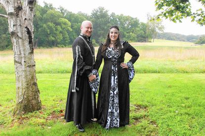 Ann Sosnowski and Joseph Stader had a medieval-themed wedding, with details such as Ann's custom black velvet gown and Joseph's tunic