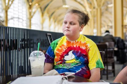 <p>Kaisy Knott sits at Starbucks in August 2017, before heading to Mexico for experimental cancer treatment.&nbsp;</p>