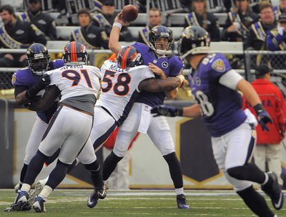 Denver Broncos outside linebacker Von Miller (58) hits Baltimore Ravens quarterback Joe Flacco (5), who throws an incomplete pass in a game in Baltimore in December 2012.