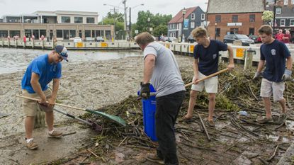A crew from the Annapolis Harbormaster's Office cleans up a field of debris that floated into Ego Alley in Annapolis Monday, July 30.