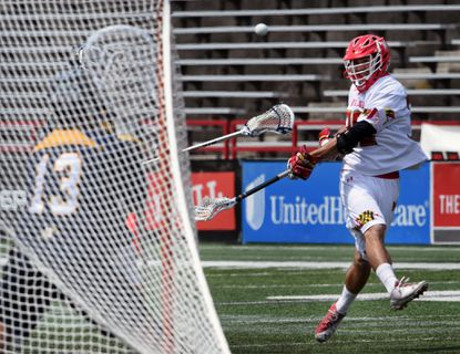 Maryland's Ben Chisolm, right, takes a shot against Quinnipiac goalie Jack Brust in the fourth quarter. Maryland defeated the Quinnipiac Bobcats 13-6 in the NCAA men's lacrosse tournament Sunday in College Park.