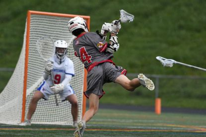 Glenelg's Evan Whatley winds up for a shot on Centennial keeper Alex Kauffman resulting in a first quarter score during a boys lacrosse game at Centennial High School on Friday, May 7, 2021.