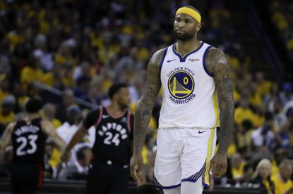 Golden State Warriors center DeMarcus Cousins (0) walks on the court during the first half of Game 3 of basketball's NBA Finals between the Warriors and the Toronto Raptors in Oakland, Calif., Wednesday, June 5, 2019.
