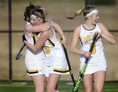 South Carroll junior Stephanie Zirkenback celebrates with teammates Morgan Collins and Laney Rogers after she scored in the final seconds of the Cavaliers' 2-0 win over the Mavericks in Woodbine Friday, March 12, 2021.