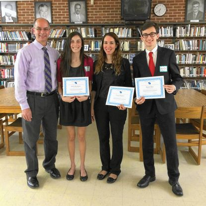 Franklin High School seniors Jaleh Montazer, Lucas Shapiro and Barret Rus, were among 10 Baltimore County Public Schools students to present the results of their independent research projects during BCPS' fourth annual Student Independent Research Symposium in the school library at Perry Hall High School, Thursday, May 19. Pictured at Perry Hall High School, from left, are: FHS Principal Patrick McCusker; Montazer; librarian Suhaila Tenly, who accepted Shapiro's certificate on his behalf, as he could not attend the event; and Rus.__- Original Credit: Meghan Goff/submitted photo