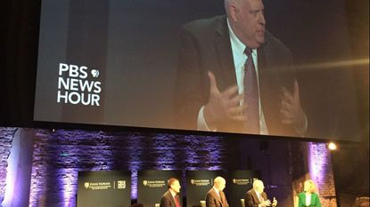 Maryland Gov. Larry Hogan, second from right, spoke Monday night at the Stavros Niarchos Foundation Parkway Theatre on North Avenue during a panel discussion about bipartisanship in today's heated political environment.