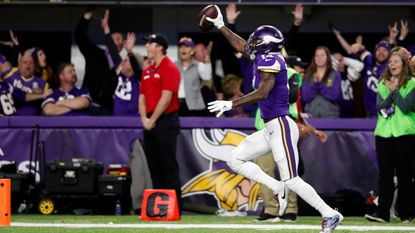 Minnesota Vikings wide receiver Stefon Riggs (14) runs to the end zone for a game winning touchdown against the New Orleans Saints during the second half of an NFL divisional football playoff game in Minneapolis, Sunday, Jan. 14, 2018. The Vikings defeated the Saints 29-24. (AP Photo/Jeff Roberson)