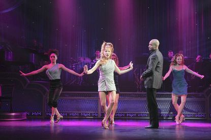 """Howard County native Ashley Blair Fitzgerald (center) stars in """"Come Fly Away"""" at the Lyric Opera House."""