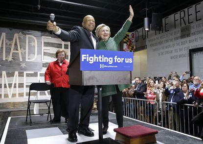 Democratic presidential candidate Hillary Clinton, right, embraces Rep. Elijah Cummings, D-Md., after being introduced and endorsed by him in front of Sen. Barbara Mikulski, D-Md., during a campaign event at City Garage in Baltimore.