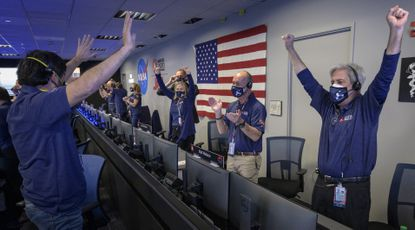 A photo provided by NASA, shows members of NASA's Perseverance rover team reacting in mission control after receiving confirmation the spacecraft successfully touched down on Mars, Thursday, Feb. 18, 2021, at NASA's Jet Propulsion Laboratory in Pasadena, Calif.