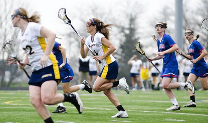 """Catonsville senior Rachel Schwaab, left, and Deb Milani, center, combined for 169 goals for the Baltimore County and Class 3A North Region champion Comets. <a href=""""http://www.baltimoresun.com/explore/baltimorecounty/sports/ph-ca-co-athletes-0613-20120613,0,5201284.story"""">Read the Catonsville story here.</a>"""