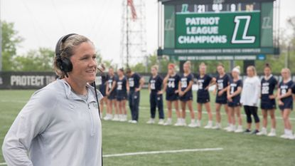 Loyola Maryland coach Jen Adams speaks on TV after defeating Navy, 21-9, to win the Patriot League title in 2019.