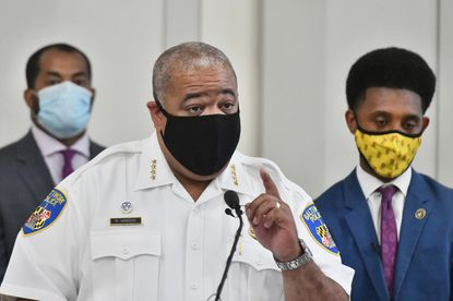 Baltimore City Police Commissioner Michael Harrison, flanked by City Council President Nick J. Mosby, left, and Mayor Brandon Scott, right, addresses the recent spate of homicides at a press conference at the War Memorial Building on May 3, 2021. (Amy Davis/Baltimore Sun).