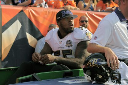 Ravens outside linebacker Terrell Suggs is carted off the field following his injury against the Denver Broncos during the 2015 season opener at Mile High Stadium. Baltimore lost Suggs for the season as well as the game, 19-13.